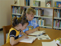 Two girls study at Benld