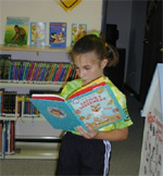 Girl reads at Benld